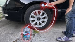 Download Filling a CAR TIRE with WATER! Mp3 and Videos