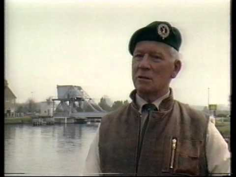 D-day Piper Bill Millin interview in 1984 beside Pegasus Bridge.