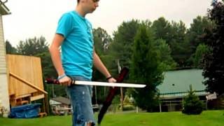 slicing a strawberry with a sword (slow motion)