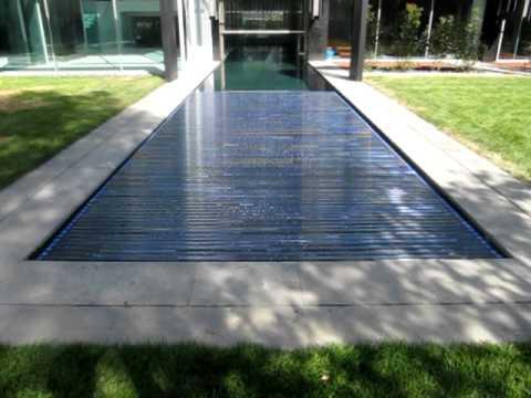 Cubierta automatica de lamas de policarbonato video de for Fundas para piscinas