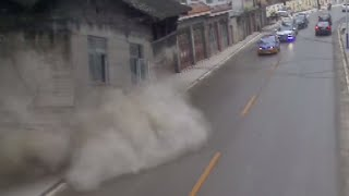 CCTV: Landslide causing house crash onto road in China