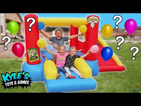 KID'S SOUR CANDY Balloon POP Challenge Inside GIANT Inflatable Water Slide! Warheads and Toxic Waste