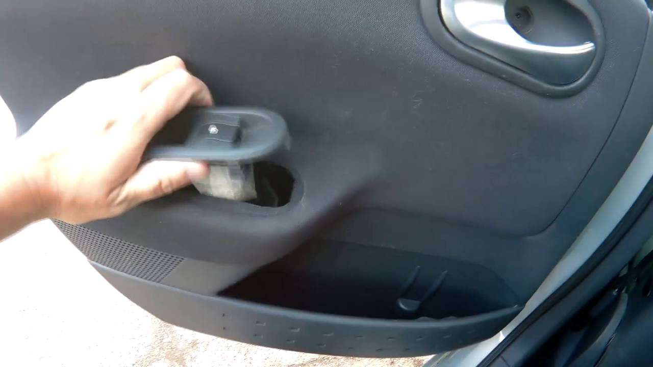 Removing A Door Card And Electric Window Regulator From