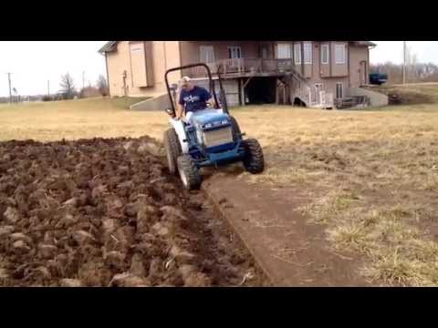Ford-New Holland 1320 4wd tractor pulling custom made single bottom plow