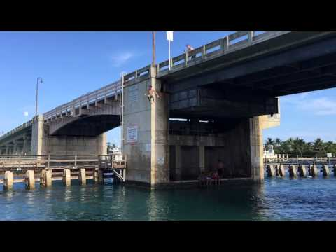 Jumping-off-the-Beach-Road-bridge-in-Jupiter-FL.