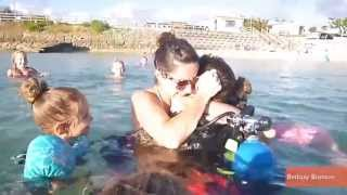 Soldier Returning Surprises Family at Beach in Scuba Gear
