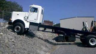 Peterbilt 357 6x6 (All-wheel drive) climbing rip rap rock bank