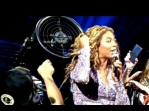 BEYONCE HAIR WEAVE GETS STUCK IN A FAN AT CONCERT DURING