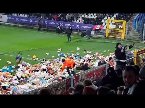 Charleroi fans throw cuddly toys onto the pitch to be given to local disabled children