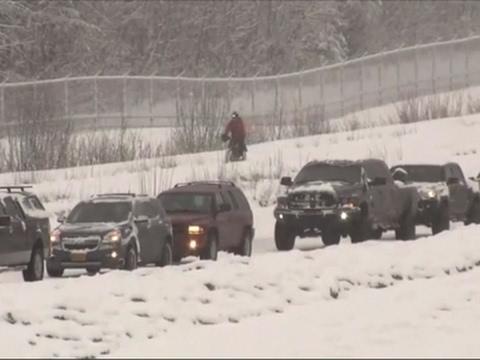 Bicyclist Undeterred by Heavy Alaska Snow Fall