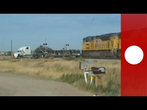 Thumbnail: Dramatic footage: Train hits trailer truck stuck on tracks, 'Holy smokes'! says witness