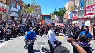 Police Officers Take a Knee With George Floyd Protestors During Peaceful Demonstration