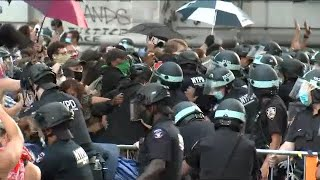 Protesters clash with police outside NYC City Hall on day of NYPD budget vote