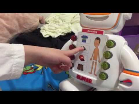 Kaden plays with Alphie robot- great buddy to learn w/
