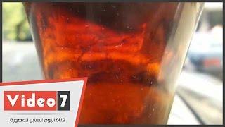 """مواطن يعرض زجاجة مياه غازية بداخلها حشرات:""""عايز تعويض نص مليون جنيه"""""""