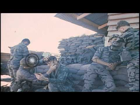 United States 50th Infantry soldiers mark their faces with black paint. HD Stock Footage