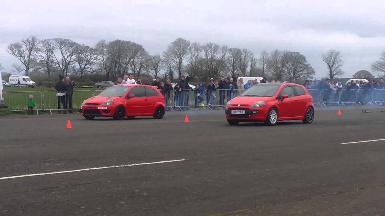 fiat punto sporting 1.4 vs ford fiesta st 2.0 - youtube