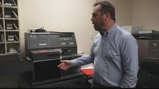 Election director says voting machines need to go