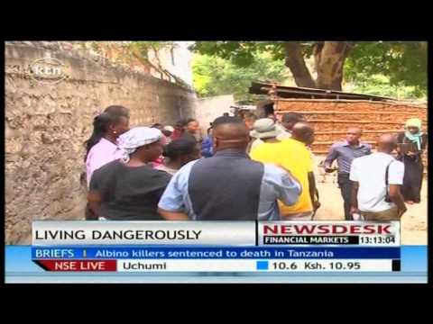 Slum residents in Mombasa raise alarm over wall hanging dangerously