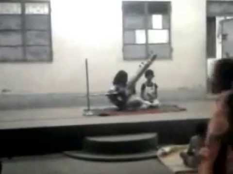 We are  playing Musical instrument Sitar on stage in the musical program !!!