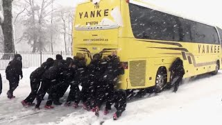 Northeastern University Woman's Basketball Team Pushes Bus Out of Snow thumbnail