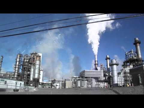 oil refinery gives off alot of pollution