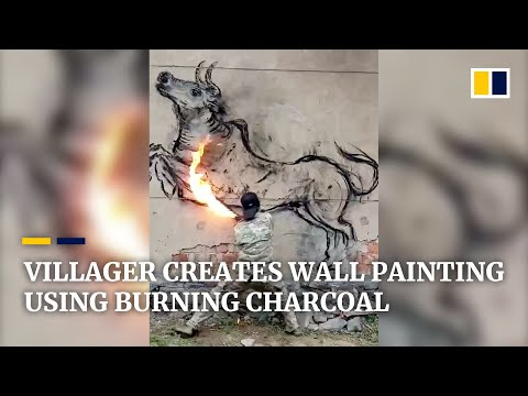 chinese-villager-creates-wall-painting-using-burning-charcoal