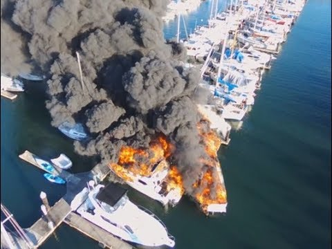 Five boats were damaged Saturday night as a fire spread through an Everett marina