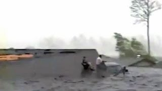 As waters from hurricane katrina continued to rise, a father and son were trapped on the roof house. see more weather caught camera, sunday at 8pm, o...