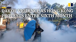 Day of violence unfolds as Hong Kong enters sixth month of protests