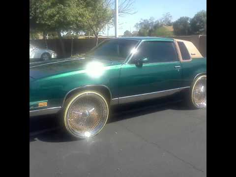 Cutlass on 24 inch gold spokes n vogues - YouTube