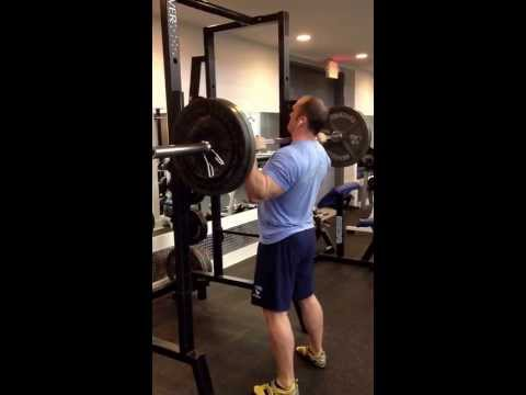 Standing Barbell Military Press: 225lbs