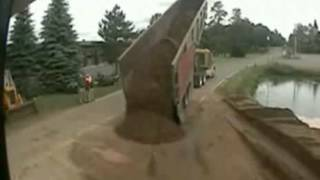 Dumb Driver Tips Over Dump Truck