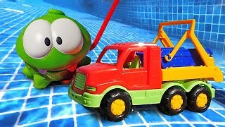Om Nom on the Beach: Funny Toy Videos for Kids with Toy Cars and Trucks.