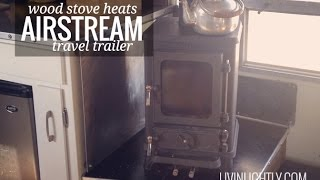 Off-grid Small Wood Stove Heating An Airstream Tiny House
