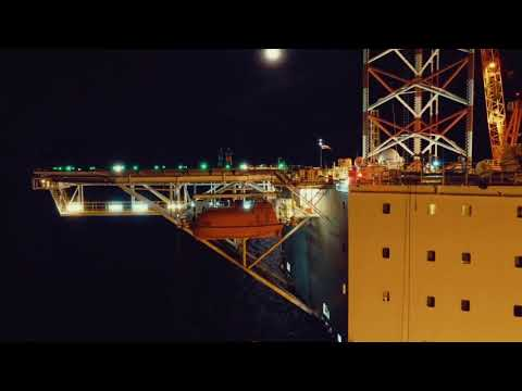 Jack Up Rig Offshore with Beautiful Sky Moonlight Night - Drone Video