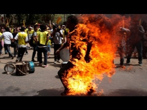 Tibetan sets himself on fire over Hu's visit to India