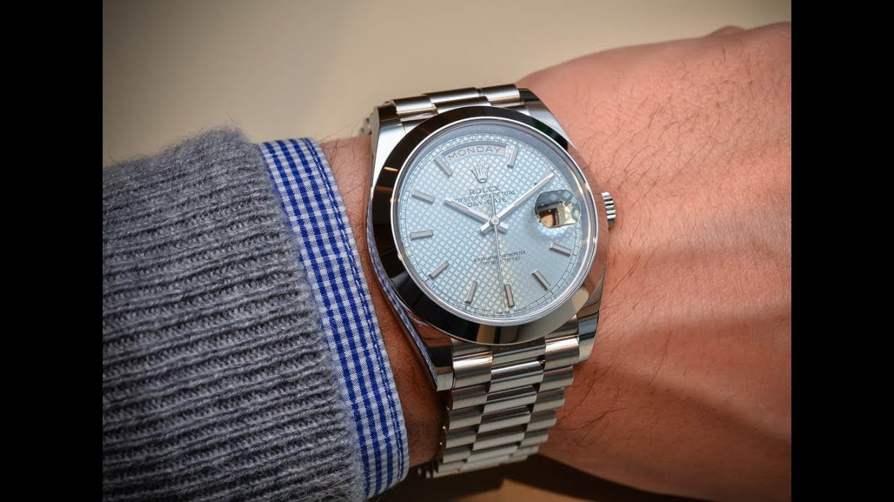19c3d409d4f6 Rolex Day-Date 228206 Ice blue dial 40 mm platinum an amazing swiss luxury  watch shining on wrist