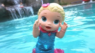 BABY ALIVE Throws Water Balloons & Jumps In Pool From Trampoline!