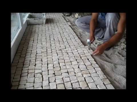 Hand made cobblestone cut and Portuguese pavement laying techniques Roc2c