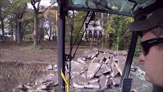 Excavator Ripping Up Concrete Driveway