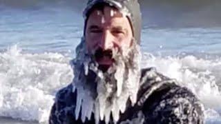 Surfers brave frigid cold Lake Michigan