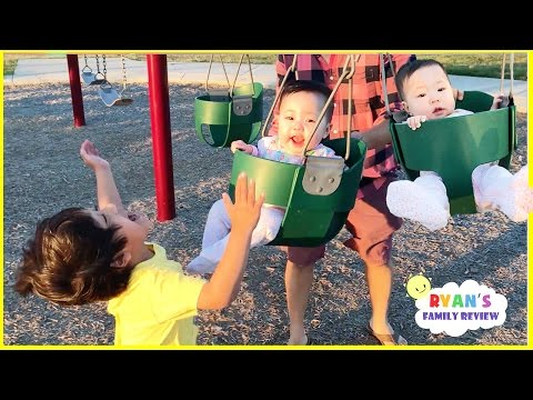 Twins first time on swing playground for kids and Baby's first trampoline Family Fun playtime