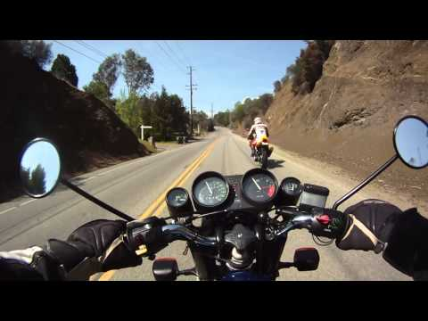Motorcycle canyon ride near Malibu on classic BMW R100RS with MZ Skorpion