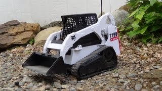 T190 Bobcat Clearing Driveway..