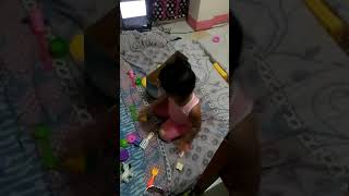 Angela cleaning toys