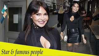 Lizzie Cundy flaunts her curves in a racy black top and leather skirt