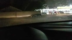 SUV stuck in flooded intersection
