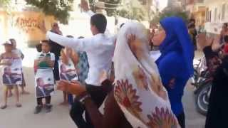 الرقص أمام لجنة المدرسة الرياضية بنات بحى الجون بمدينة الفيوم