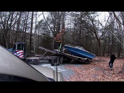 Removing an Old Boat with a Rollback Truck